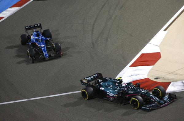 Sebastian Vettel, Aston Martin AMR21, leads Fernando Alonso, Alpine A521