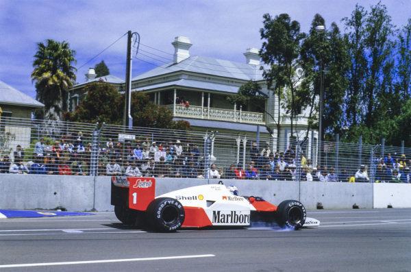 Alain Prost, McLaren MP4-2C TAG, locks a wheel.