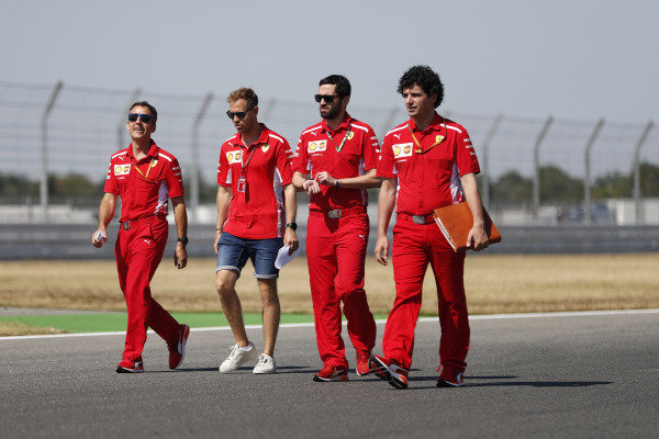 Sebastian Vettel, Ferrari, conducts a track walk with colleagues.