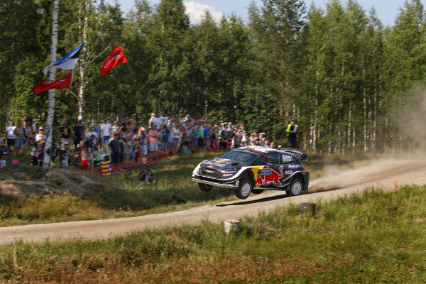 Sebastien Ogier entertains the crowds that pack the route of Rally Finland