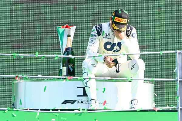 Pierre Gasly, AlphaTauri, 1st position, sits down on the podium to contemplate his victory
