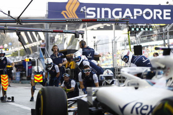 Lance Stroll, Williams FW41, approaches his pit area.