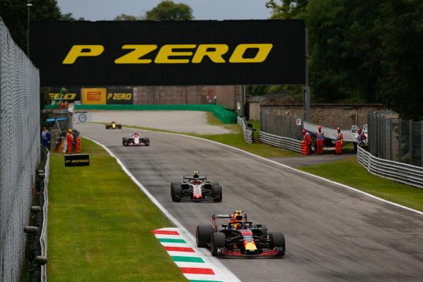 Max Verstappen, Red Bull Racing RB14 Tag Heuer, leads Kevin Magnussen, Haas F1 Team VF-18 Ferrari.