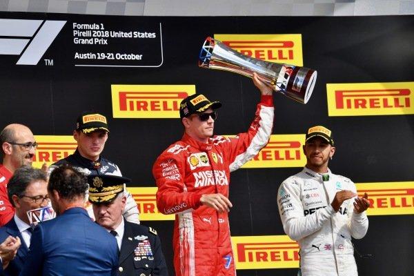 (L to R): Carlo Santi, Ferrari Race Engineer, Max Verstappen, Red Bull Racing, Kimi Raikkonen, Ferrari with the trophy and Lewis Hamilton, Mercedes AMG F1