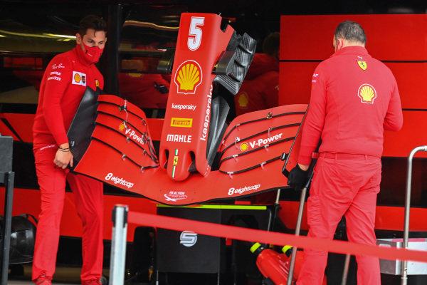 Ferrari mechanics with Sebastian Vettel, Ferrari SF1000 nose cone