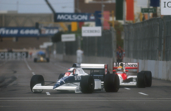 1990 United States Grand Prix.Phoenix, Arizona, USA.9-11 March 1990.Jean Alesi (Tyrrell 018 Ford) leads Ayrton Senna (Mclaren MP4/5B Honda). They finished in 2nd and 1st positions respectively.Ref-90 USA 13.World Copyright - LAT Photographic