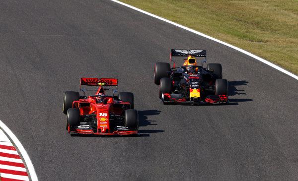 Charles Leclerc, Ferrari SF90, leads Max Verstappen, Red Bull Racing RB15