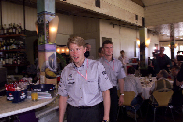 1999 Australian Grand Prix.Albert Park, Melbourne, Australia. 5-7 March 1999.McLaren Mercedes-Benz drivers Mika Hakkinen and David Coulthard (behind) arrive at a press lunch before the Grand Prix.World Copyright - Winter/LAT Photographic