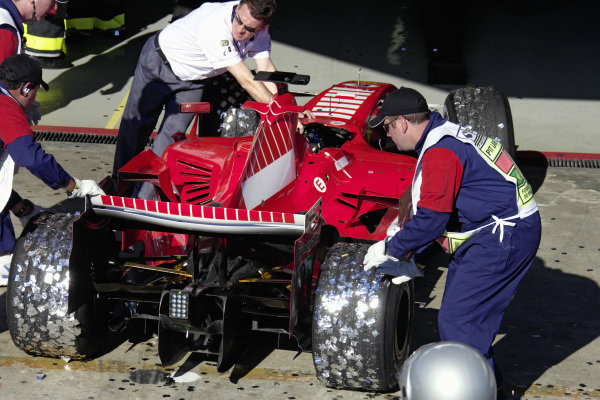 Felipe Massa's Ferrari 248 F1 being pushed to FIA scrutineering after the race, the tyres covered in celebratory confetti.
