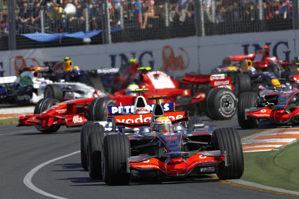Lewis Hamilton, McLaren MP4-23 Mercedes leads Robert Kubica, BMW Sauber F1.08 as Felipe Massa, Ferrari F2008 spins in the background.