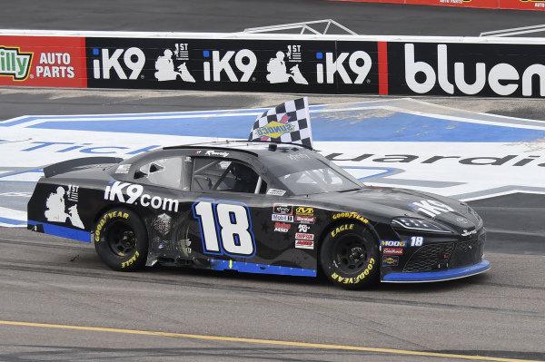 #18: Kyle Busch, Joe Gibbs Racing, Toyota Supra Extreme Concepts/iK9, celebrates after winning the iK9 Service Dog 200 race in Phoenix.