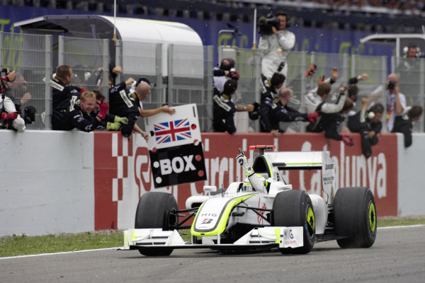 Jenson Button, Brawn BGP 001 Mercedes celebrates with his team as he claims another victory.