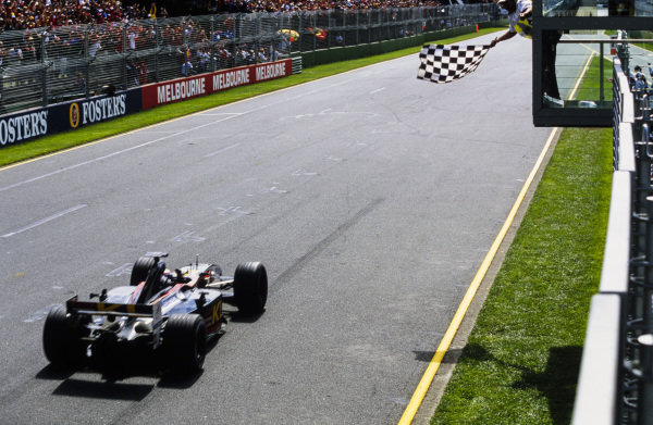 Mark Webber, Minardi PS02 Asiatech, crosses the finish line to secure an unlikely fifth on his grand prix debut.