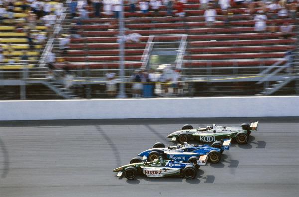 Michel Jourdain Jr, Bettenhausen, Lola B1/00 Ford, battles with Patrick Carpentier, Forsythe Racing, Reynard 01i Ford, and Dario Franchitti, Team Green, Reynard 01i Honda.