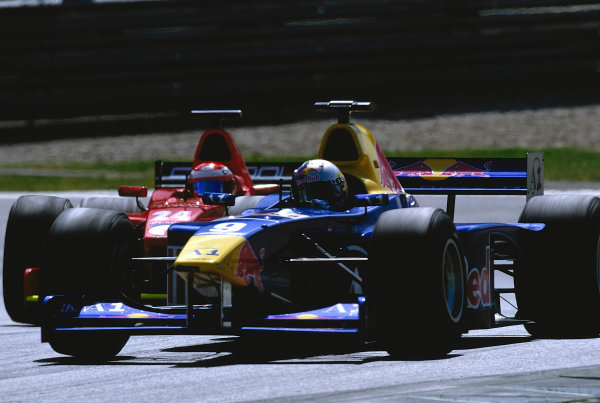 2002 F3000 ChampionshipA1-Ring, Austria. 11th May 2002.Patrick Friessacher (Red Bull Jnr), leads Enrico Toccacelo (Coloni F3000), action.World Copyright: Clive Rose/LAT Photographicref: 35mm Image A19