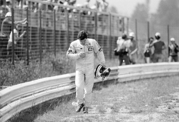 Second placed Alan Jones (AUS) Williams, walks back to the pits after stopping out on the circuit during practice.
