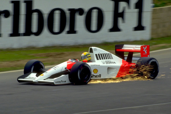 Ayrton Senna, McLaren MP4-6 Honda, with sparks flying at Bridge corner.