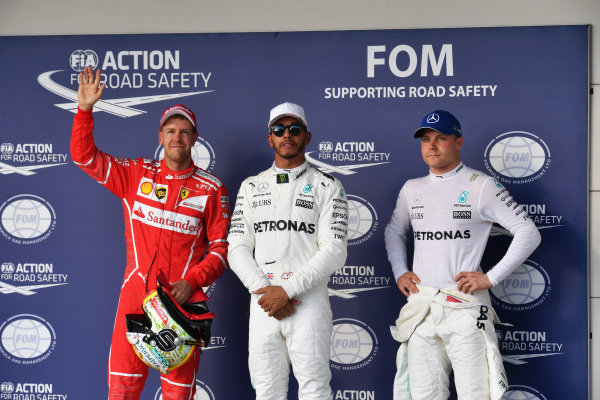 (L to R): Sebastian Vettel (GER) Ferrari, pole sitter Lewis Hamilton (GBR) Mercedes AMG F1 and Valtteri Bottas (FIN) Mercedes AMG F1 celebrate in parc ferme at Formula One World Championship, Rd17, United States Grand Prix, Qualifying, Circuit of the Americas, Austin, Texas, USA, Saturday 21 October 2017.