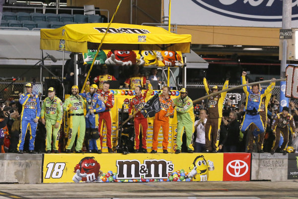 #18: Kyle Busch, Joe Gibbs Racing, Toyota Camry M&M's crew members celebrate the race and championship wins
