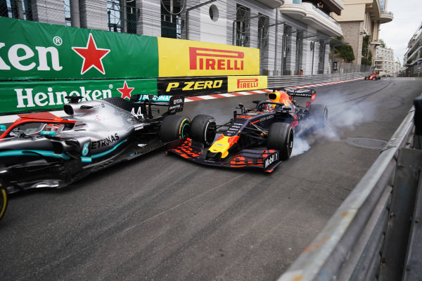 Max Verstappen, Red Bull Racing RB15, makes contact with leader Lewis Hamilton, Mercedes AMG F1 W10, in the closing stages of the race