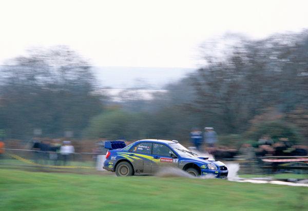 2003 World Rally ChampionshipRally of Great Britain, Wales. 6th - 9th November 2003.Petter Solberg / Phillip Mills, Subaru Impreza WRC 2003. Water splash action.World Copyright: McKlein/LATref: 35mm Image WRC_GB_04 jpg