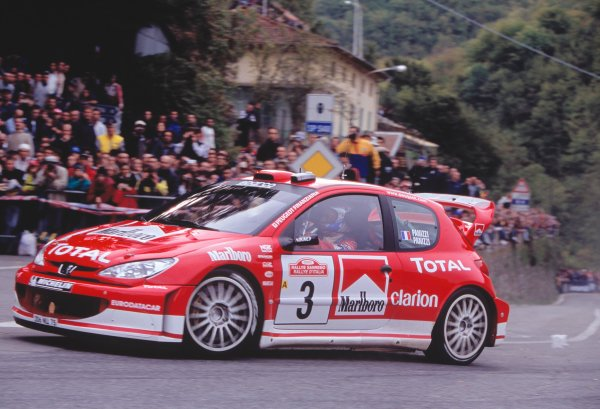 2003 World Rally ChampionshipRally of San Remo, Italy. 2nd - 5th October 2003.Harri Rovanpera / Risto Pietilainen, Peugeot 206 WRC. Turning, Crowd, Action.World Copyright: McKLEIN/LATref: 35mm Image WRCSANREMO16 jpg