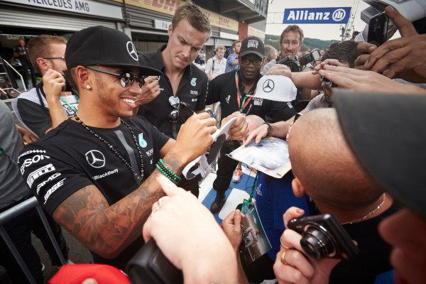Spa-Francorchamps, Spa, Belgium. Thursday 20 August 2015. Lewis Hamilton, Mercedes AMG, signs autographs for fans. World Copyright: Steve Etherington/LAT Photographic ref: Digital Image SNE14976
