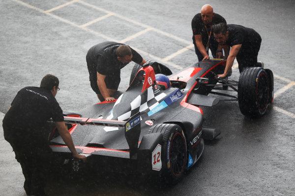FIA Formula E Test Day, Donington Park, UK.  10th August 2015. Jacques Villeneuve (CAN), Venturi VM200-FE-01, returns to the pit lane under heavy rain Photo: Sam Bloxham/FIA Formula E/LAT ref: Digital Image: _G7C4521