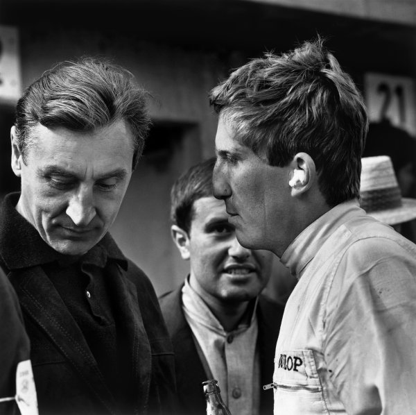 Nurburgring, Germany.30/7-1/8 1965.Jochen Rindt (Cooper T77-Climax) 4th position, chats with Team Manager, Roy Salvadori in the pits, portrait.World Copyright: LAT Photographic.Ref: 30397.