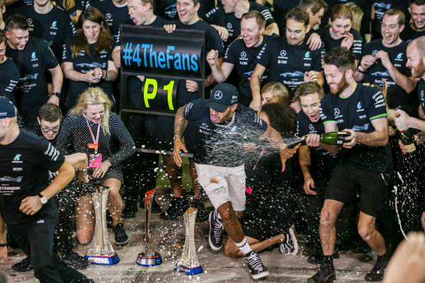 Yas Marina Circuit, Abu Dhabi, United Arab Emirates. Sunday 26 November 2017. Valtteri Bottas, Mercedes AMG, 1st Position, Lewis Hamilton, Mercedes AMG, 2nd Position, family, friends and the Mercedes team celebrate victory. World Copyright: Charles Coates/LAT Images  ref: Digital Image AN7T2737