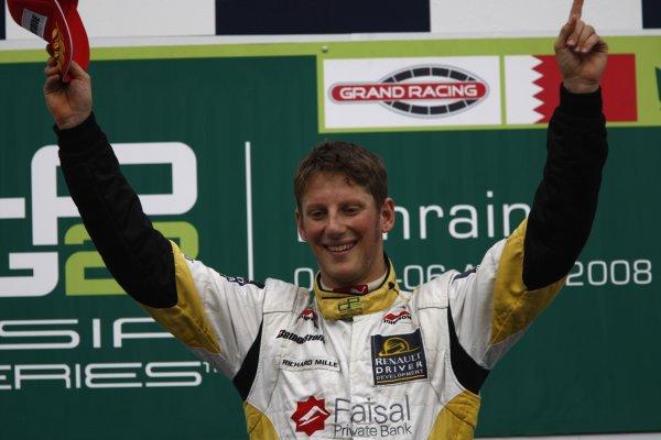 2008 GP2 Asia Series. Saturday Race.Bahrain International Circuit. Sakhir, Bahrain. 5th April. Romain Grosjean (FRA, ART Grand Prix) celebrates victory on the podium. World Copyright: Andrew Ferraro/GP2 Series Media Service. Service ref:__H0Y2648 jpg