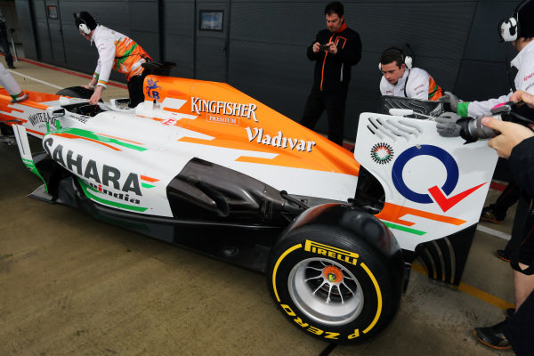 Engineers push the Force India VJM06 into the garage. Force India VJM06 Launch, Silverstone, England, 1 February 2013.