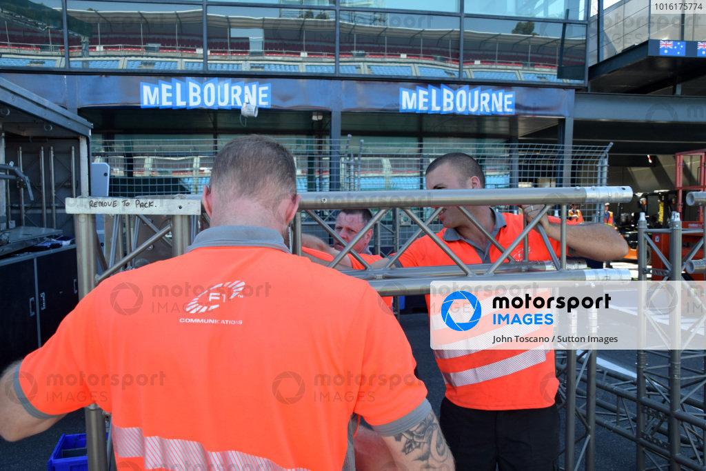 Workers in pit lane.Formula One World Championship, Rd1, Australian Grand Prix, Preparations, Albert Park, Melbourne, Australia, Sunday 9 March 2014.
