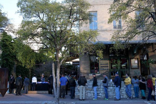 Fans queue early for the FOTA Fans Forum. FOTA Austin Fans Forum, Cedar Street Courtyard, Austin, Texas, Wednesday 13 November 2013.