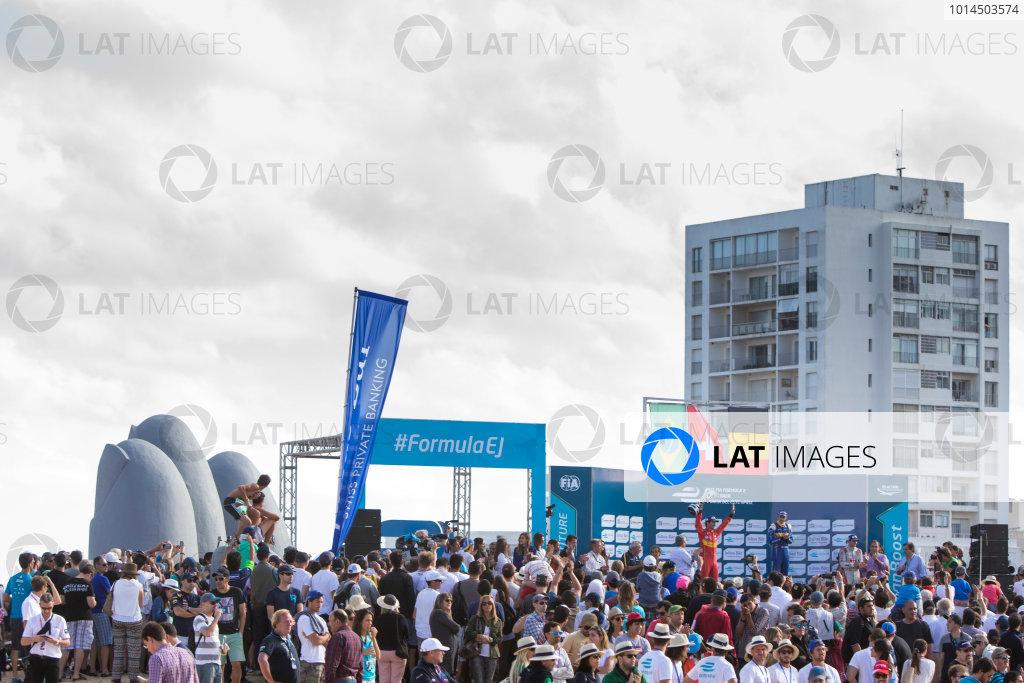 2015/2016 FIA Formula E Championship. Punta del Este ePrix, Punta del Este, Uruguay. Saturday 19 December 2015. Sebastien Buemi (SUI), Renault e.Dams Z.E.15, Lucas Di Grassi (BRA), ABT Audi Sport FE01 and Jerome D'Ambrosio (FRA) Dragon Racing - Venturi VM200-FE-01 on the podium. Photo: Zak Mauger/LAT/Formula E ref: Digital Image _L0U8975