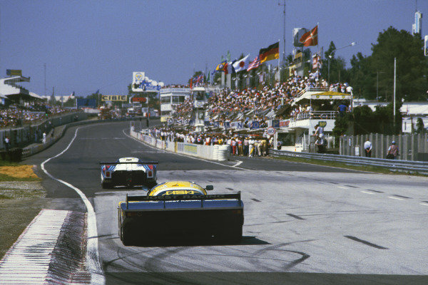 Le Mans, France. 16th -17th  June 1984.Klaus Ludwig/Henri Pescarolo (Porsche 956), 1st position, follows a Lancia down the start/finish straight, action.World Copyright: LAT Photographic.