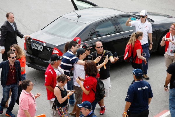 Interlagos, Sao Paulo, Brazil. Sunday 9 November 2014. Pastor Maldonado, Lotus F1, poses for photos with fans. World Copyright: Charles Coates/LAT Photographic. ref: Digital Image _J5R5438