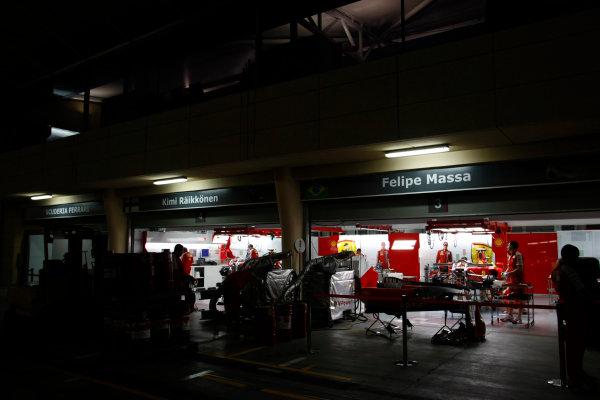 Bahrain International Circuit, Sakhir, Bahrain24th April 2009The Ferrari garage at night. Garages. Atmosphere. World Copyright: Charles Coates/LAT Photographicref: Digital Image _26Y0765