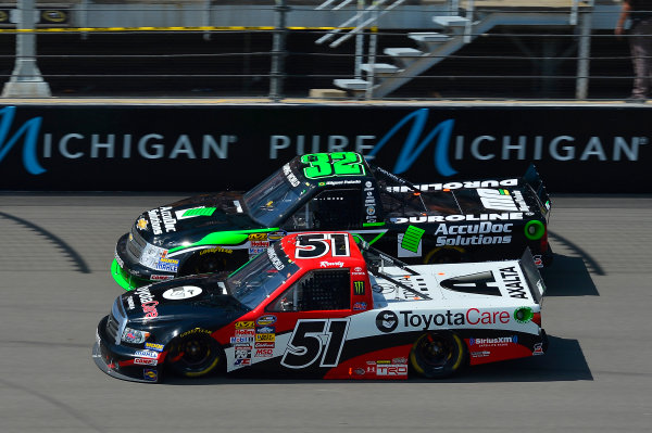 August 16-17, 2013, Brooklyn, Michigan USA Kyle Busch and Miguel Paludo trucks © 2013, Brian Czobat LAT Photo USA