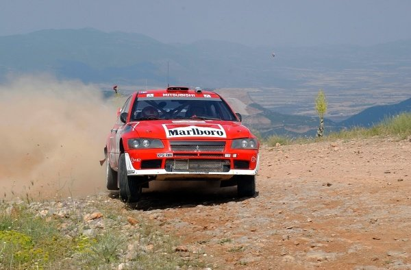 Alister McRae (GBR) Mitsubishi Lancer EVO VII WRC on stage 5.