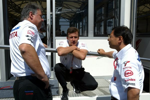(L to R): Norbert Kreyer (GER) Toyota Senior General Manager of Race and Test Engineeringchats with Olivier Panis (FRA) Toyota and Keizo Takahashi (JPN) Toyota Technical Co-Ordinator.