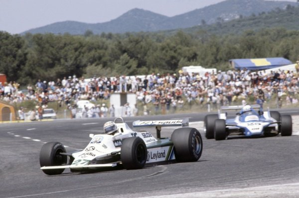 1980 French Grand Prix.Paul Ricard, France. 27-29 June 1980.Alan Jones (Williams FW07B-Ford Cosworth), 1st position, leads Didier Pironi (Ligier JS11/15-Ford Cosworth), 2nd position.World Copyright: LAT PhotographicRef: 35mm transparency 80FRA16