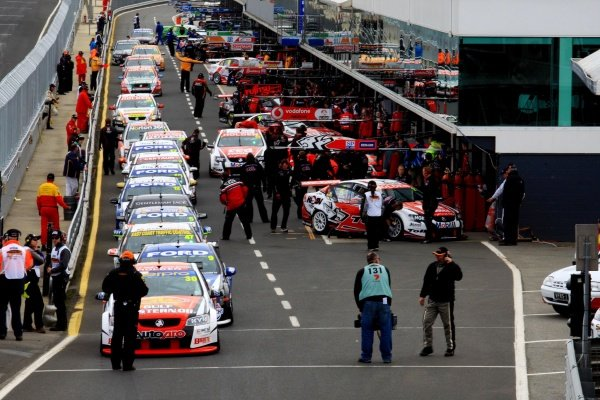 The cars line up for qualifying in the pit lane.Australian V8 Supercars, Rd10, L&H 500, Phillip Island, Australia, 12 September 2010.