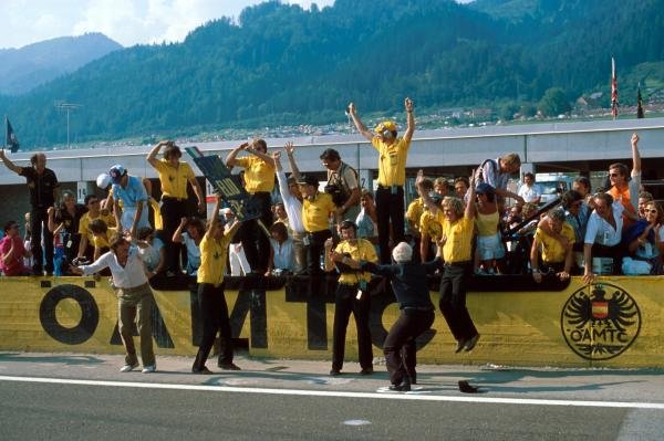Colin Chapman (GBR), Lotus team owner, gets to throw his cap in victory one last time before his death in December 1982. The Lotus team celebrate the win of Elio de Angelis (ITA). Austrian Grand Prix, Osterriechring, Austria. 15 August 1982.