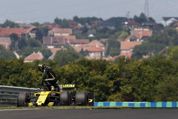 Nico Hulkenberg, Renault Sport F1 Team R.S. 18, climbs from his car after stopping on track.