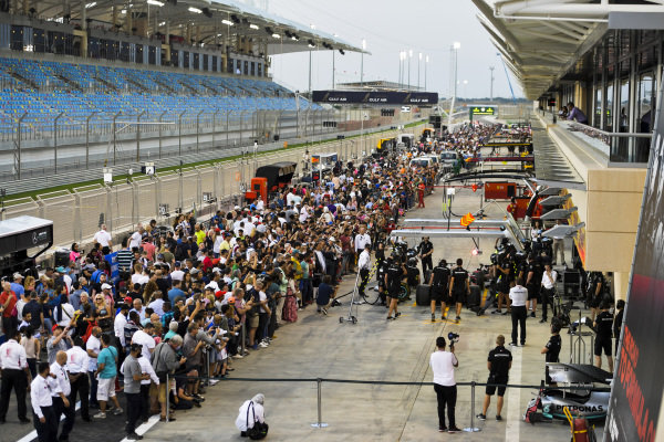 Fans in pit lane watching Mercedes AMG F1 team do pit stop practice