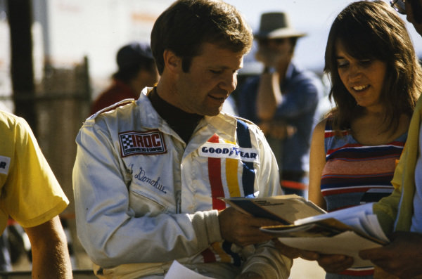 Mark Donohue signs autographs for fans.