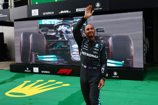 Pole man Sir Lewis Hamilton, Mercedes, waves from Parc Ferme