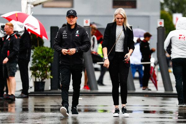 Valtteri Bottas, Mercedes AMG F1, arrives in the paddock.