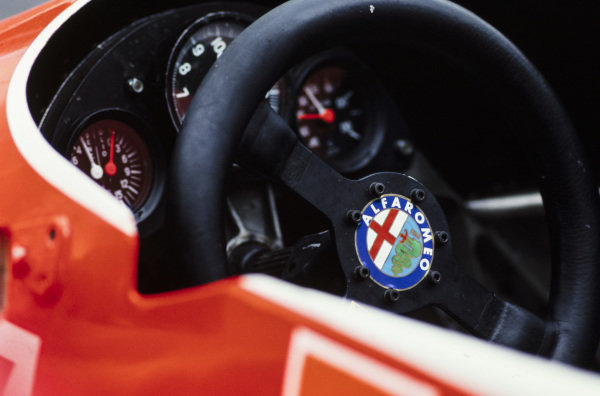 The steering wheel and dash in one of the Alfa Romeo 179s.